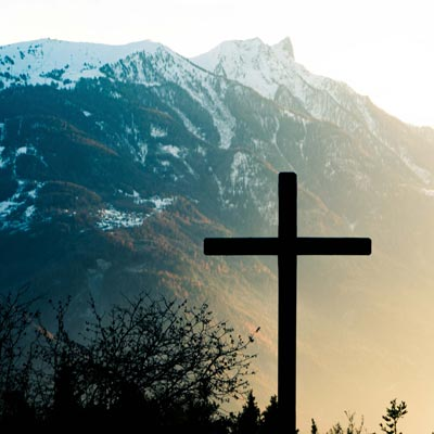 cross with mountain