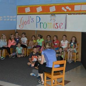 kids in room with teacher