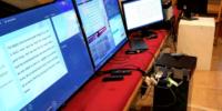 computer monitors sitting on church pew